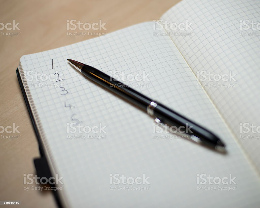 Pen with list stock photo