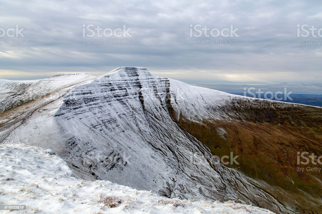 Pen y Fan and  Corn Du mountain with snow on the summit. stock photo