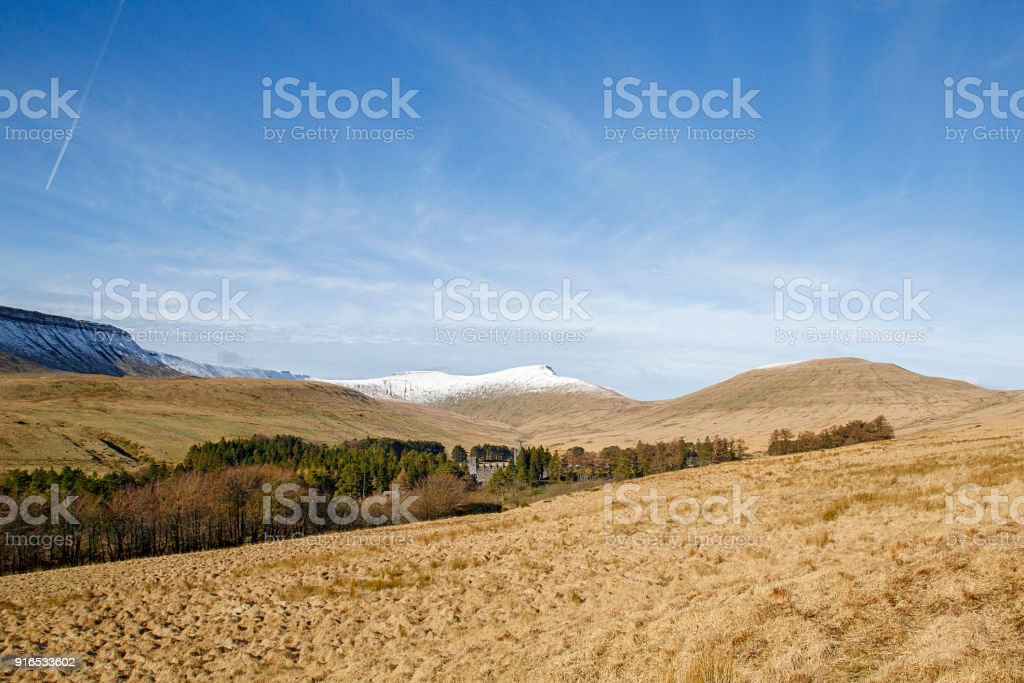 Pen y Fan in the Brecon Beacons National Park with winter snow at the Upper Neuadd Reservoir on the Taf Trail. stock photo
