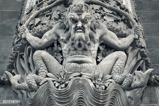 Sintra, Portugal - December 30, 2014: A sculpture of strange angry looking creature above a doorway on an exterior wall of the Pena National Palace in Sintra.
