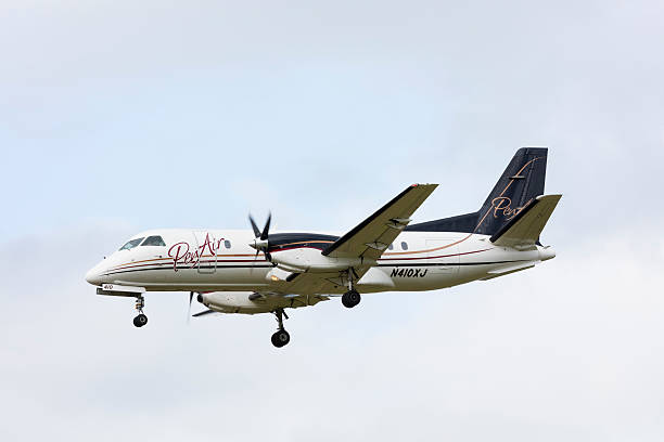 PenAir Saab 340 Portland, Oregon, USA - May 27, 2016: A PenAir Saab 340 landing at Portland International Airport. PenAir currently operates twenty Saab aircraft in the United States. saab stock pictures, royalty-free photos & images