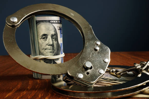 Penalty or bail bond concept. Money and handcuffs. stock photo