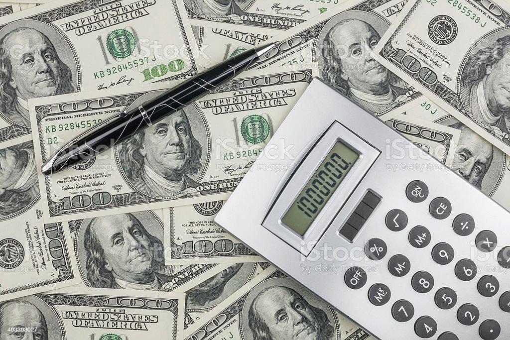 Pen,calculator and dollars  closeup. stock photo