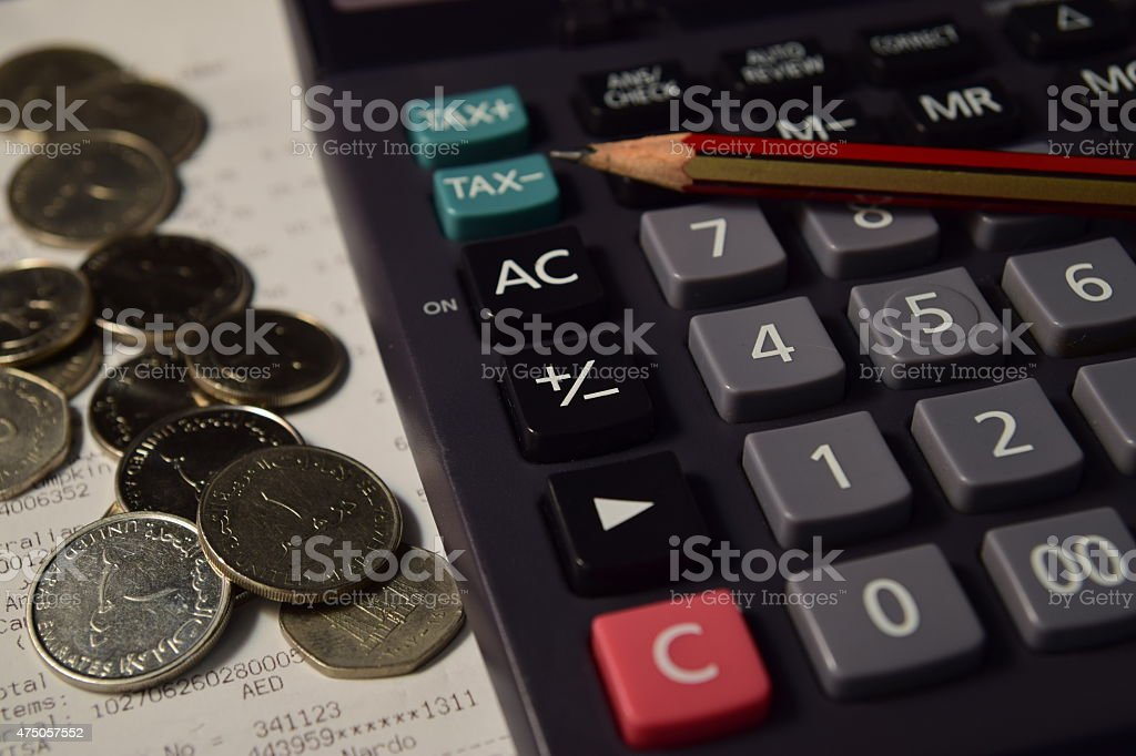 Pencil and Calculator beside the Bill and Coins stock photo