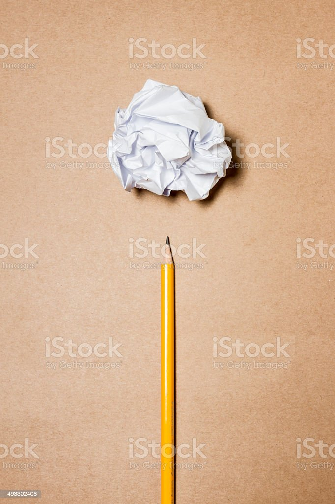 pencil and crumpled paper. stock photo