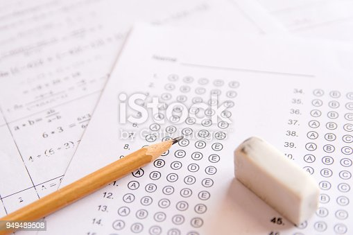 806639724 istock photo Pencil and eraser on answer sheets or Standardized test form with answers bubbled. multiple choice answer sheet 949489508