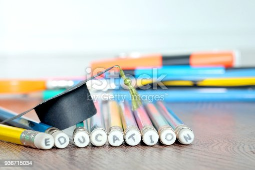 istock Pencil and Graduation hat ,Educational Equipment Background 936715034