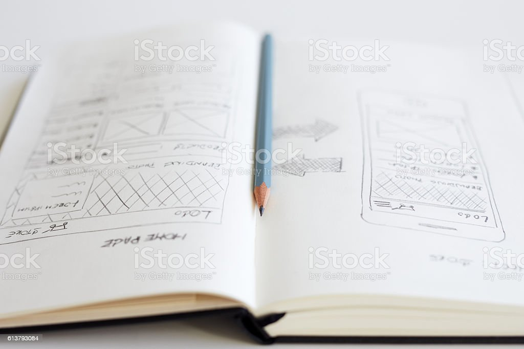 Pencil and open diary with sketch web design stock photo