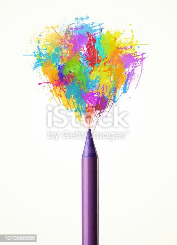 istock Pencil close-up with colored paint splashes 1070566996