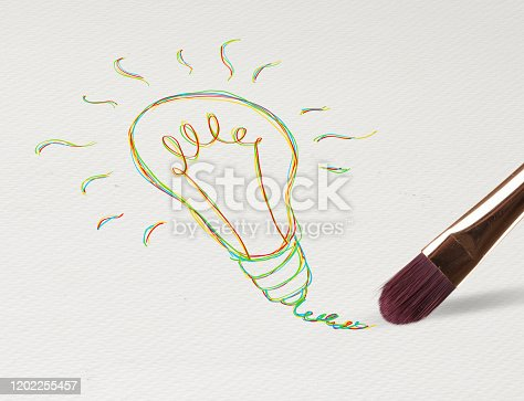 istock Pencil drawing bulb on paper 1202255457