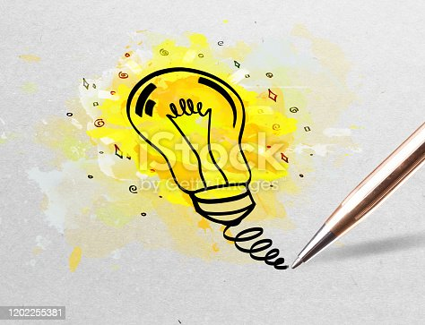 istock Pencil drawing colorful bulb on paper 1202255381