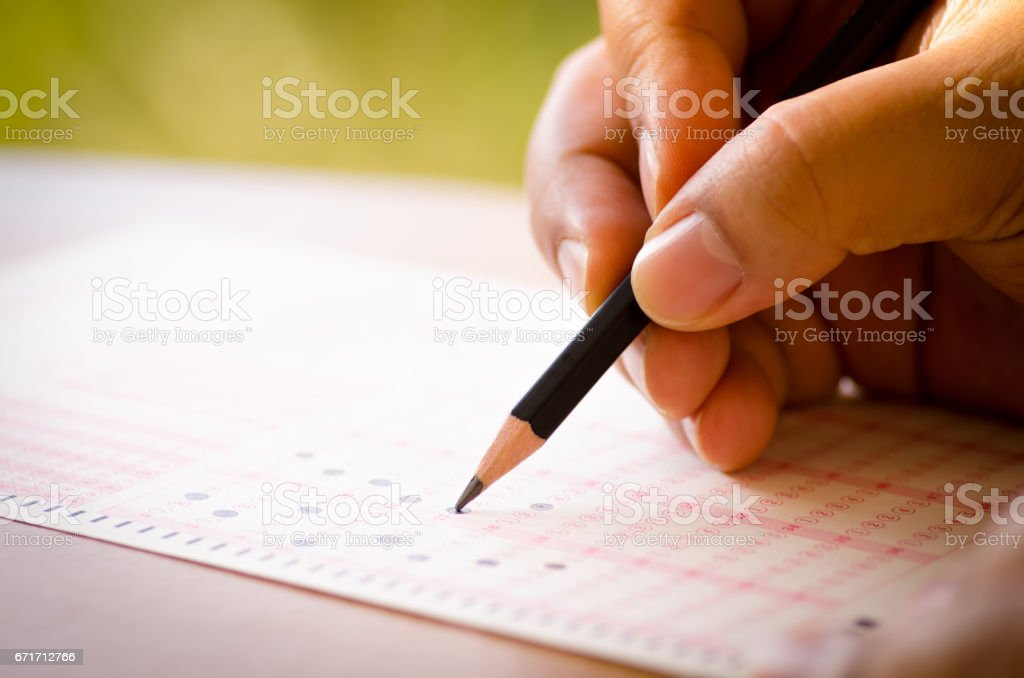 Pencil drawing selected choice on answer sheets stock photo