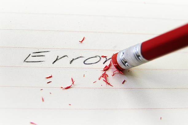 Pencil eraser correcting a spelling error stock photo