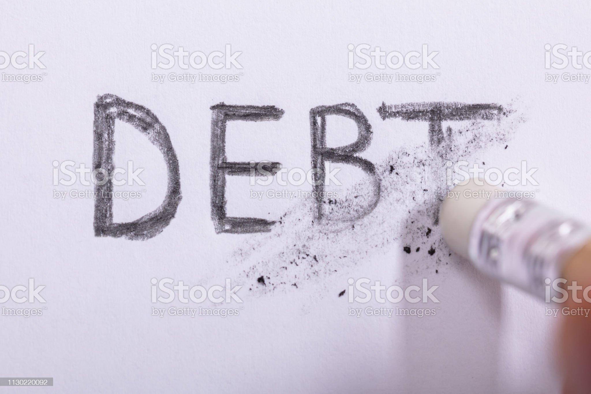 Pencil Eraser Erasing Debt Word Close-up Of Pencil Eraser Erasing Debt Word On White Paper Debt Stock Photo Bad Debts