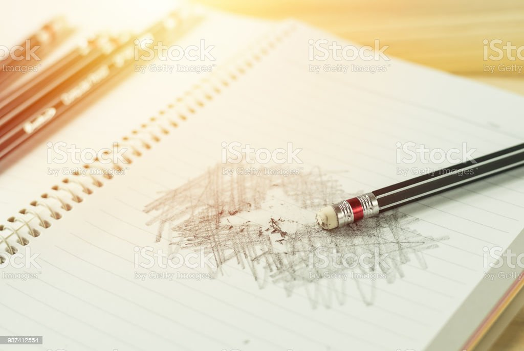 pencil eraser with eraser dust on notebook, remove pencil drawing...