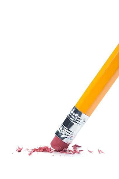 Pencil erasing on a white surface