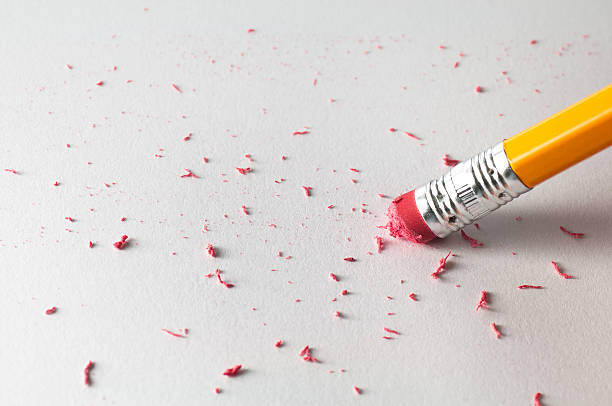 Pencil Erasing on White Paper stock photo