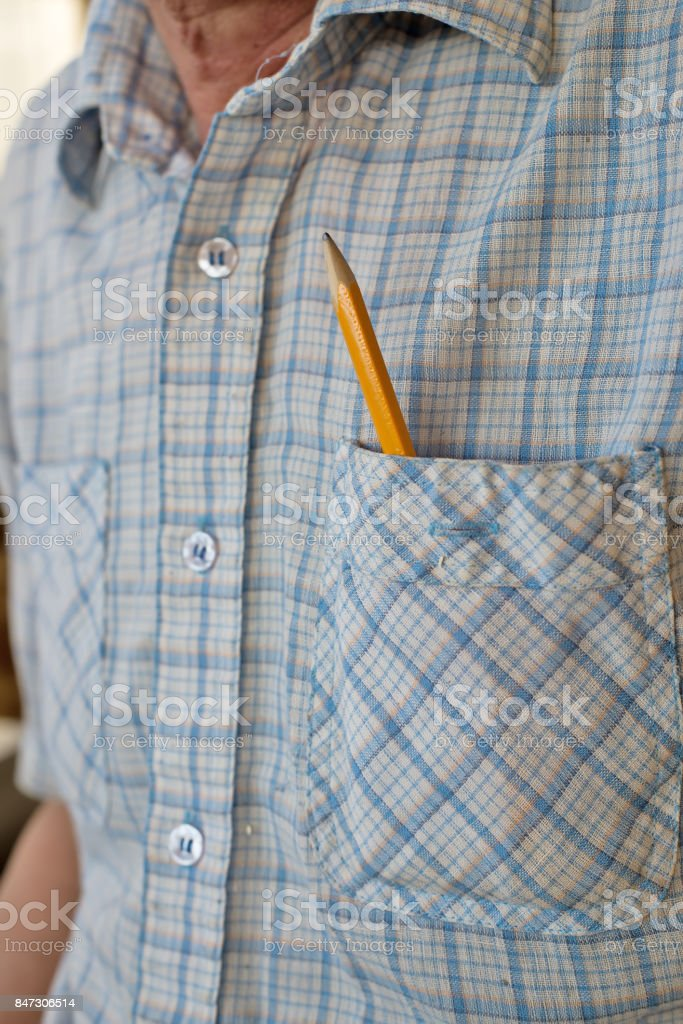 Pencil in the shirt pocket. Carpenter closely. stock photo