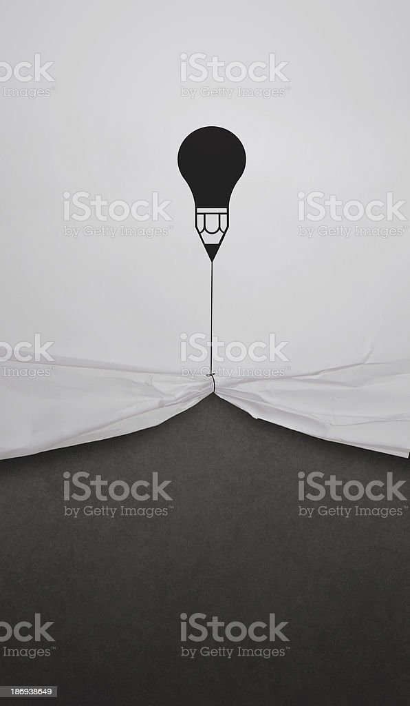 pencil lightbulb draw rope open wrinkled paper show blank black royalty-free stock photo