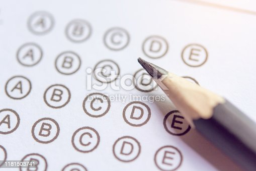806639724istockphoto Pencil on answer sheets or Standardized test form with answers bubbled. multiple choice answer sheet 1181503741