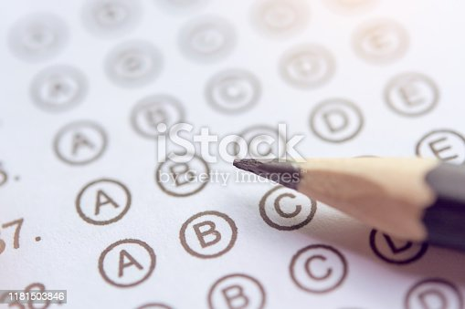 806639724istockphoto Pencil on answer sheets or Standardized test form with answers bubbled. multiple choice answer sheet 1181503846