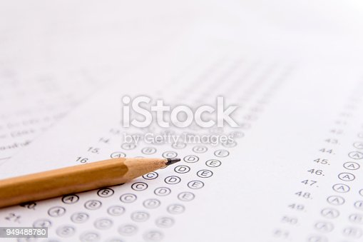 istock Pencil on answer sheets or Standardized test form with answers bubbled. multiple choice answer sheet 949488780