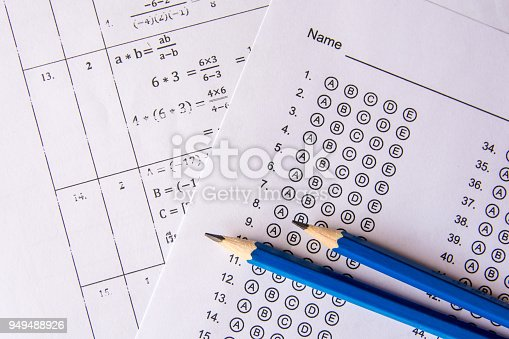 istock Pencil on answer sheets or Standardized test form with answers bubbled. multiple choice answer sheet 949488926