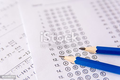 istock Pencil on answer sheets or Standardized test form with answers bubbled. multiple choice answer sheet 949489254