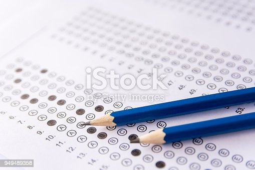 806639724 istock photo Pencil on answer sheets or Standardized test form with answers bubbled. multiple choice answer sheet 949489358
