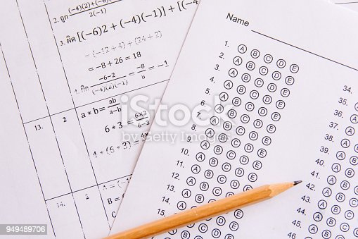 806639724istockphoto Pencil on answer sheets or Standardized test form with answers bubbled. multiple choice answer sheet 949489706