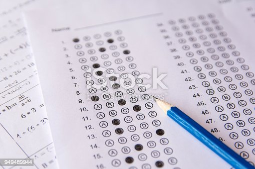 806639724istockphoto Pencil on answer sheets or Standardized test form with answers bubbled. multiple choice answer sheet 949489944