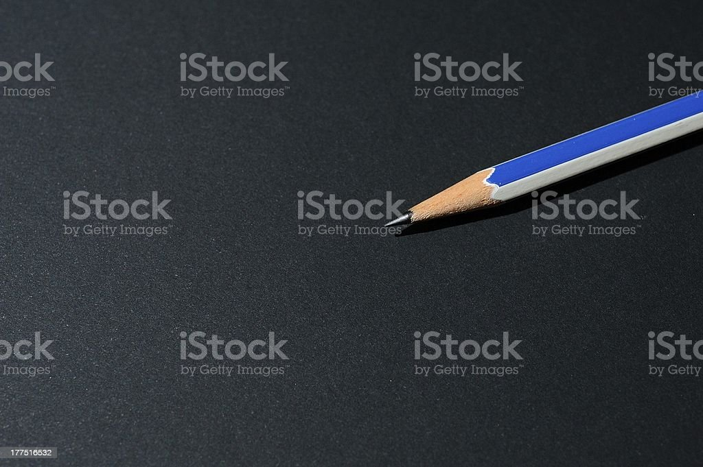 Pencil on Black Paper royalty-free stock photo