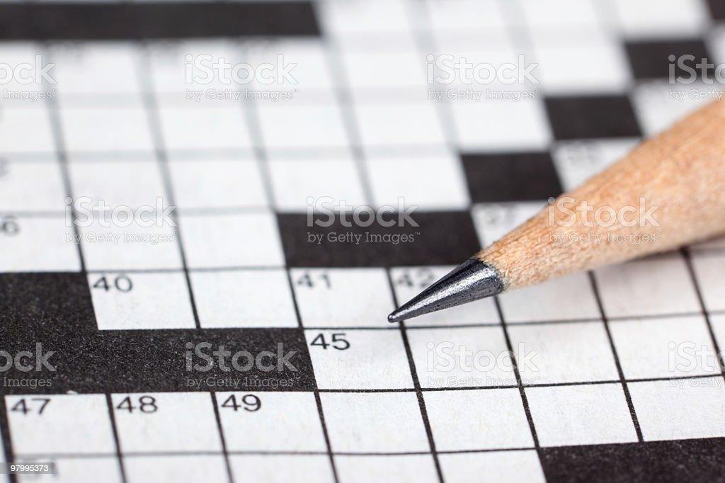 Pencil on crossword royalty free stockfoto