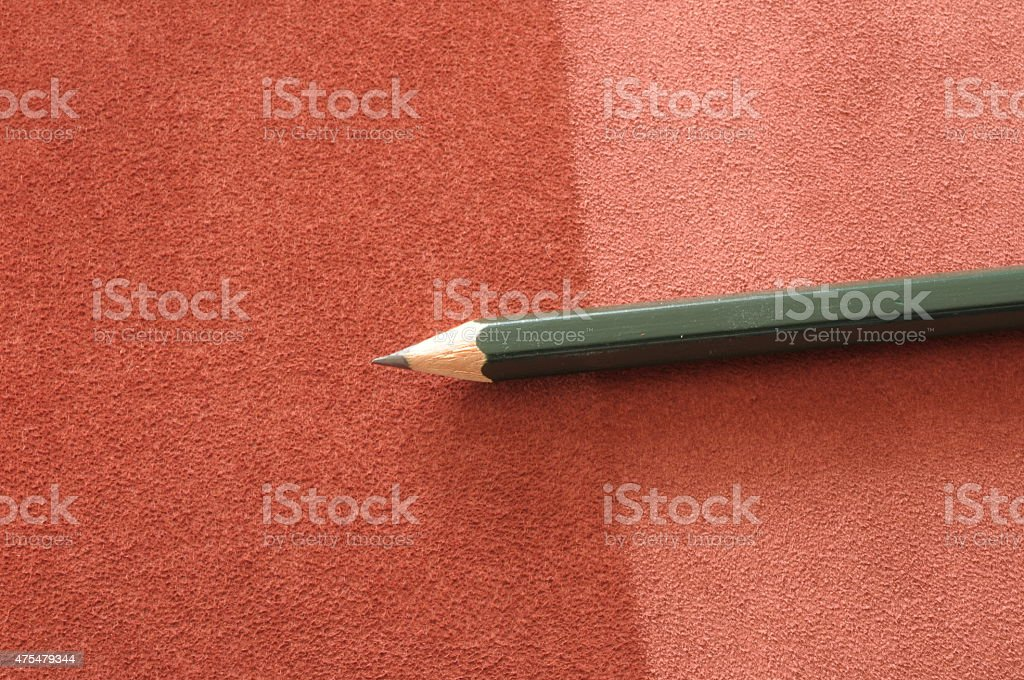 pencil on leather background stock photo