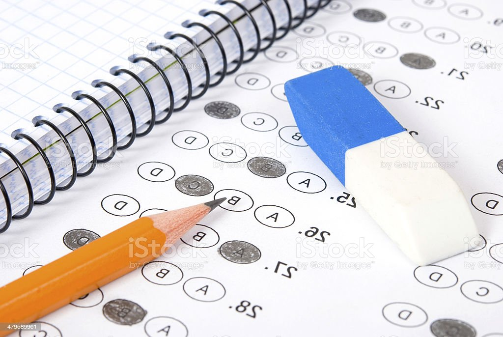 Pencil on test page stock photo