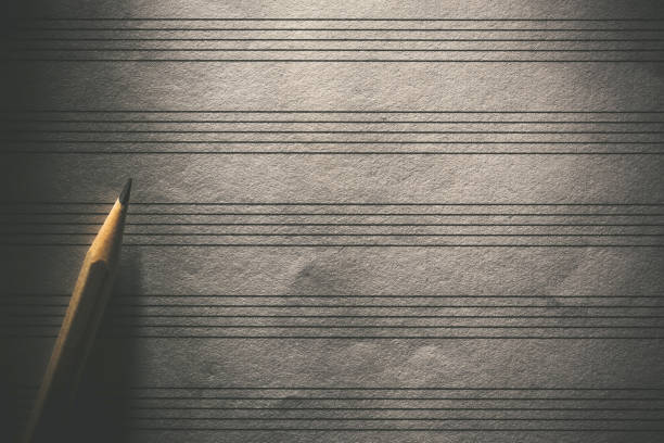 Pencil on the blank sheet music stock photo