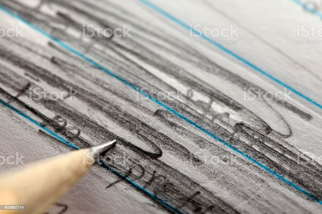 Pencil Scribbling Out Unwanted Text stock photo
