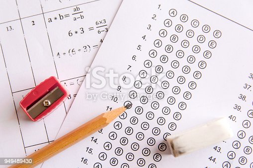 istock Pencil, Sharpener and eraser on answer sheets or Standardized test form with answers bubbled. multiple choice answer sheet 949489430