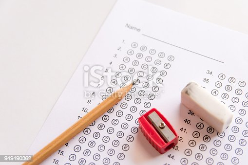 806639724 istock photo Pencil, Sharpener and eraser on answer sheets or Standardized test form with answers bubbled. multiple choice answer sheet 949490362