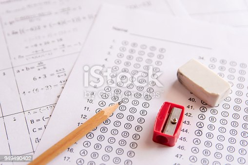 806639724 istock photo Pencil, Sharpener and eraser on answer sheets or Standardized test form with answers bubbled. multiple choice answer sheet 949490402