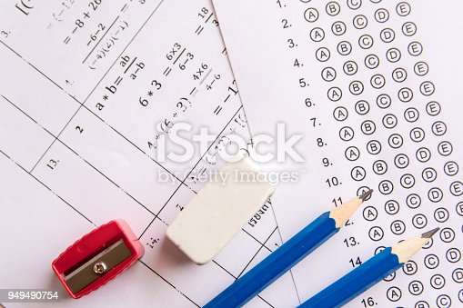 istock Pencil, Sharpener and eraser on answer sheets or Standardized test form with answers bubbled. multiple choice answer sheet 949490754