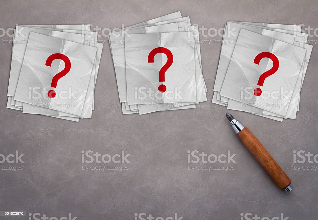 pencil with red question mark symbol on grey background stock photo