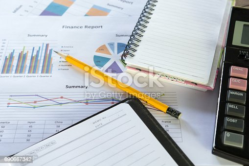 istock Pencil yellow with business graphs and charts report , calculator on desk of financial planing 690667342