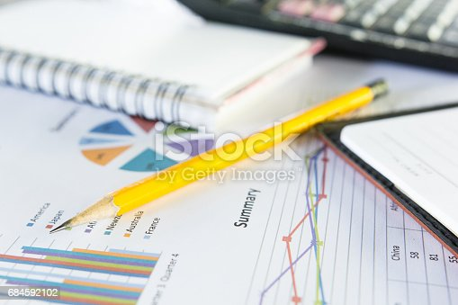 istock Pencil yellow with business graphs 684592102