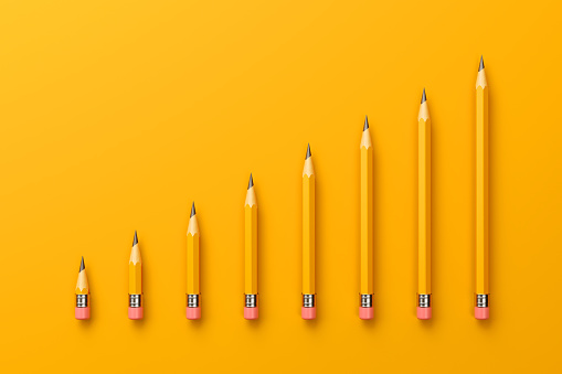 2B pencils forming a bar graph on yellow background. Horizontal composition with copy space.