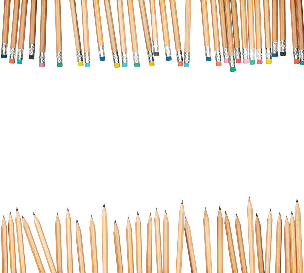 Pencils frame a white background space available for copyspace stock photo