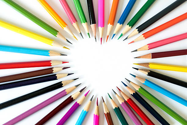 pencils in love. - coloured pencil stock photos and pictures
