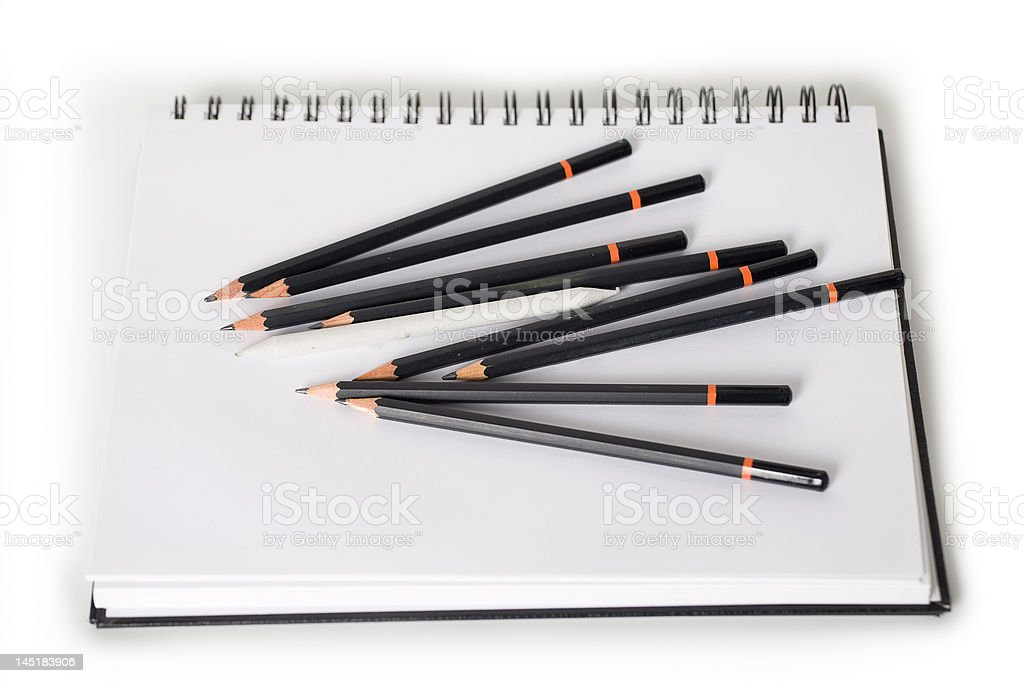 Pencils on a drawing pad royalty-free stock photo