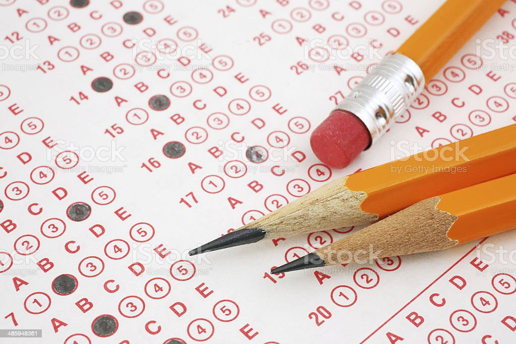Pencils on Exam Sheet stock photo
