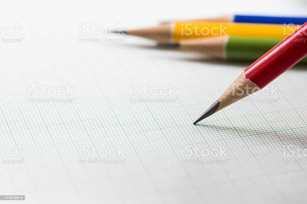 pencils on graph paper stock photo
